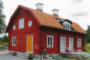 Levande hantverkstradition med genuina timmerhus